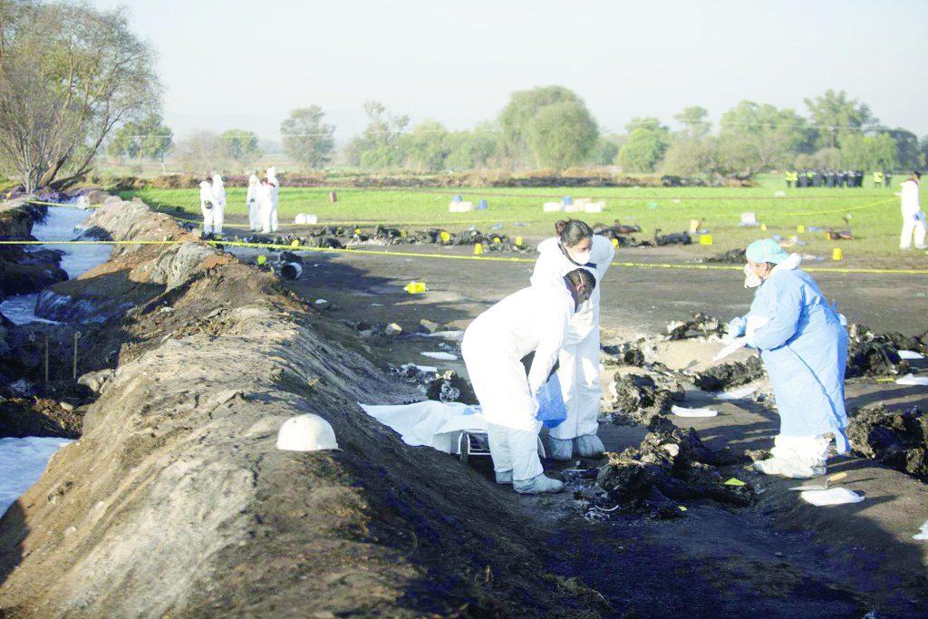 un-campo-regado-de-cuerpos-quemados