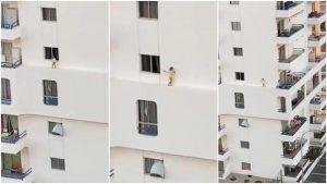 VIDEO: Niña camina por cornisa de edificio