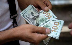 Por coronavirus, se dispara dólar a los 21.34 pesos