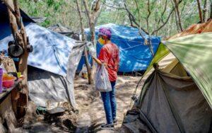 'Que nos saque de este lugar'; campamento de migrantes hace llamado a Biden